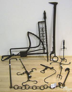 Two wrought iron fireplace cranes 19th c