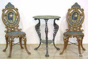 Pair of cast iron garden chairs late 19th c