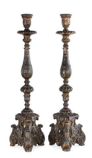 A Pair of Baroque Style Patinated Giltwood Candlesticks