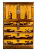 A Campaign Burrwood Cabinet