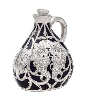 A Porcelain Silver Overlay Pitcher